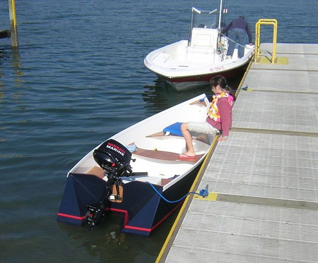 The Tango Skiffs can be launched single-handed with a small trailer ...